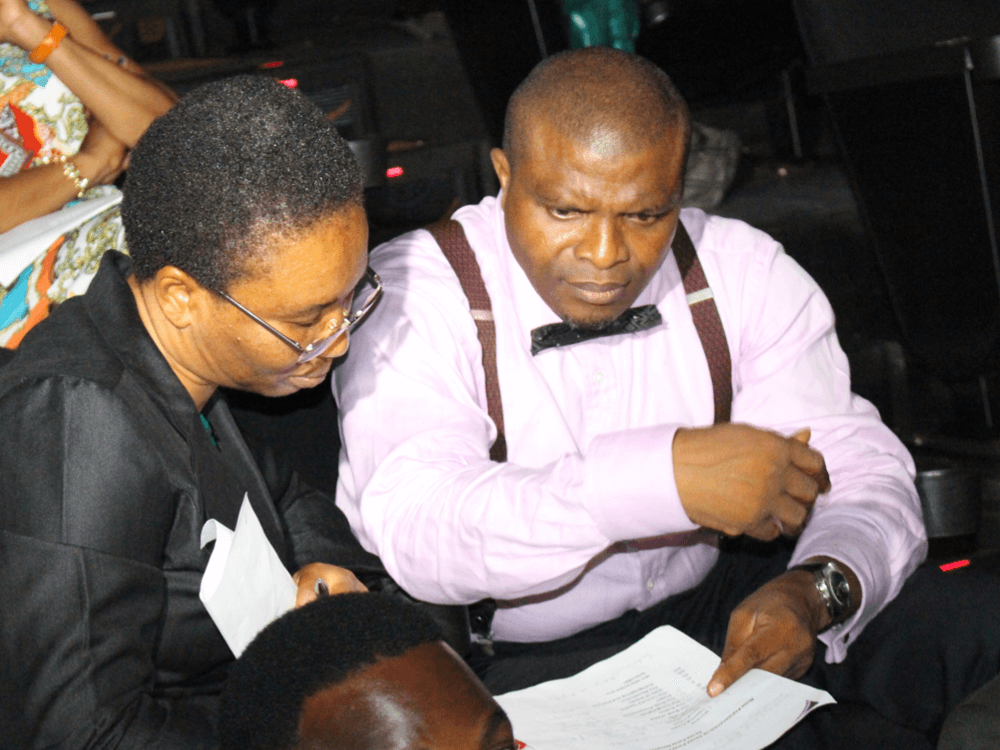 Reverend Olusegun and Clara Obafemi, brainstorming