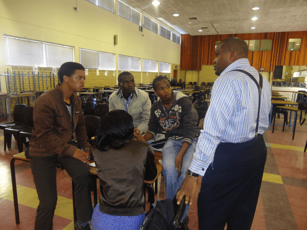 Reverend Olusegun Obafemi engaging youths in a discussion